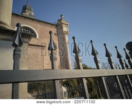 Detail of a fence with wrought iron points on the border and protection of a building.