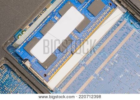 cyber data attack concept : broken laptop , crash motherboard , memory hard disk electronic hardware problems on white desktop , backup information maintenance