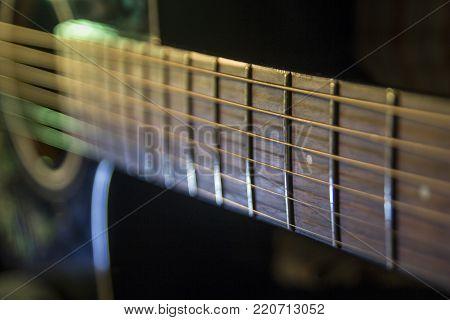 Guitar close up, blur light play the guitar on the concert