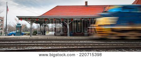 A train leaving the Manassas, Virginia station for Washington, DC that's been recently decorated for Christmas.