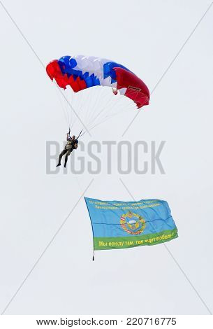 Alabino, Moskow region, Russia - July 29, 2017: Russian paratroopers demobilized with a flag walking during the Feast of Russian Air Assault Troops