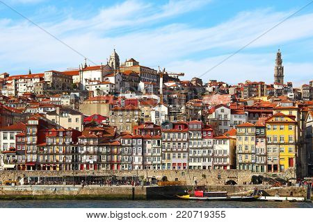 Ribeira district with touristic embankment and bright old buildings in the heart of Porto, Portugal