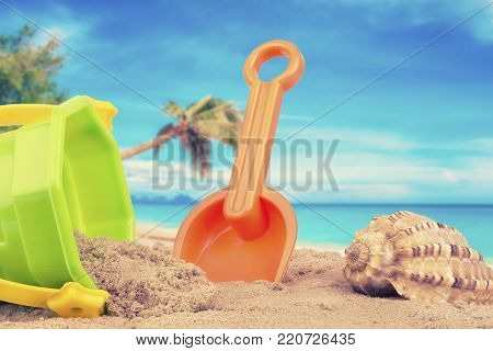 Bucket and shovel toys at the beach.