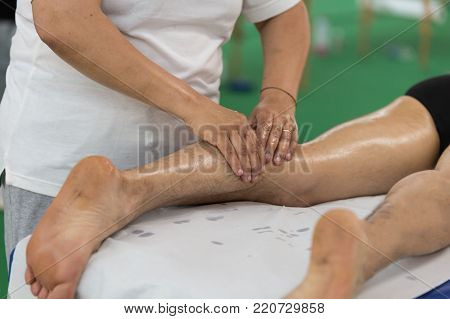 Athlete's Calf Muscle Professional Massage Treatment after Sport Workout: Fitness and Wellness.