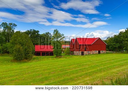 Wooden red cottage houses in scenery of Sweden