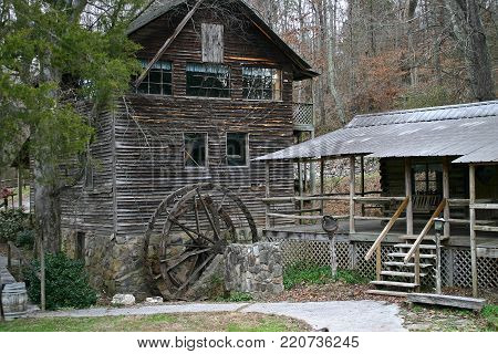 an abandoned and neglected gristmill and shed