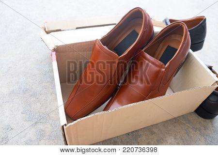 New brown male shoes on box brown
