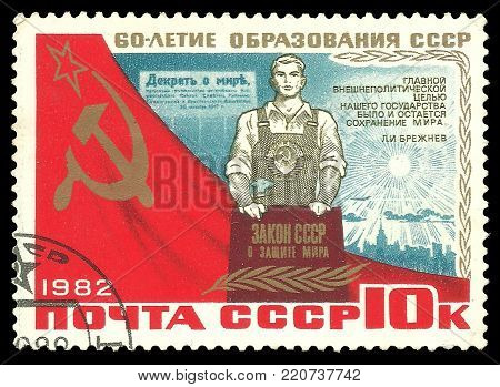 USSR - circa 1982: Stamp printed by USSR, Color edition on 60th Anniversary formation of state, shows Worker holding peace text, circa 1982
