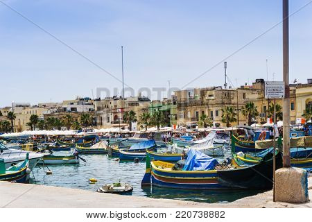 MARSAXLOKK, MALTA - June 28, 2017: Mediterranean traditional colorful boats in Malta