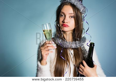 tired drunk girl does not sleep all night and celebrates the new year, drank a lot of champagne