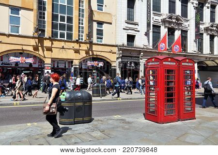 LONDON, UK - JULY 7, 2016: People visit Coventry Street in London, UK. London is the most populous city in the UK with 13 million people living in its metro area.