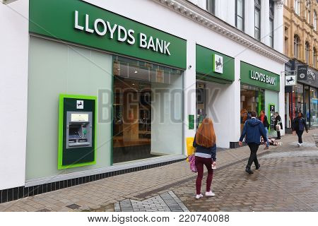 LEEDS, UK - JULY 11, 2016: People walk by Lloyds Bank in Leeds, UK. Lloyds Bank is a public limited company and is one of biggest banks in the UK.