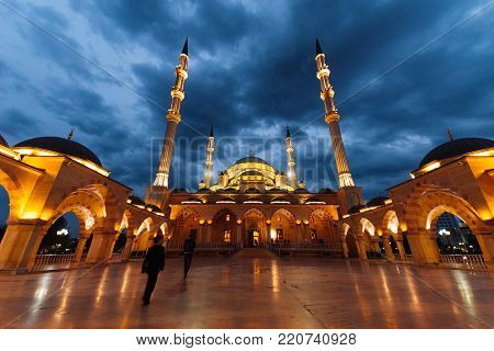 majestic Arab Moslem mosque glows under the evening sky