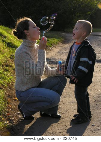 Mother With Son And Bubble