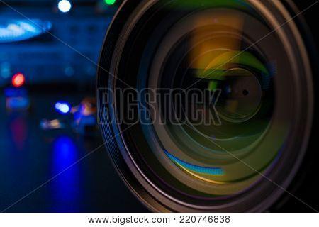 Photo Camera or Video lens close-up on black background DSLR objective