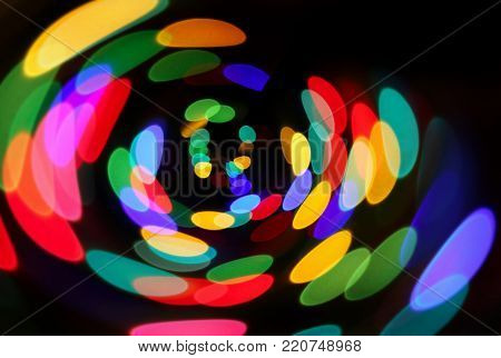 Bright unfocused colorful lights in night, holiday background