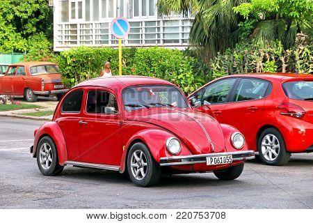 Havana, Cuba - June 6, 2017: Red motor car Volkswagen Beetle in the city street.