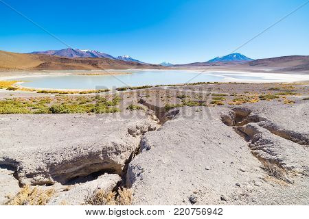 Panoramic view of  frozen salty lake on the way to the famous Uyuni Salt Flat, travel destination in Bolivia.