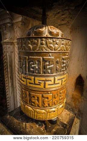 A prayer wheel is a cylindrical wheel made from metal, wood, stone, leather or coarse cotton. Traditionally, the mantra Om Mani Padme Hum is written in Sanskrit on the outside of the wheel.