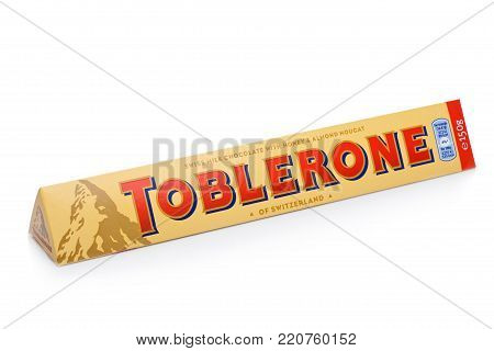 London, Uk -december 07, 2017: Toblerone Swiss Milk Chocolate With Honey And Almond Nougat On White.