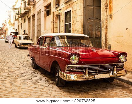 Havana, Cuba - December, 3 2017: Red old and classical car in road of old Havana (Cuba)