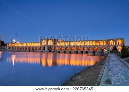 Khaju Bridge after Dark. Also Pol-e Khaju, built by the Persian king Shah Abbas II during Safavid era. Bridge is 133 metres long and has 24 arches. Serving as a bridge and a dam as well (or a weir) and links the Khaju quarter with the Zoroastrian quarter