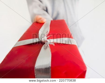 Gift box in the hands of a person