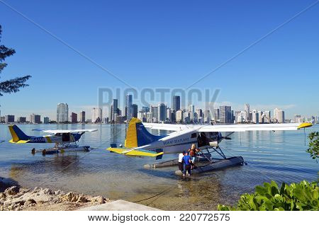 Airborne sightseeing is a popular albeit not inexpensive tourist attraction.  Here two Key Biscayne based  seaplane charter aircraft are boarding passengers for a fifteen minute flight over Miami and Miami Beach,Florida on 14 December 2017.