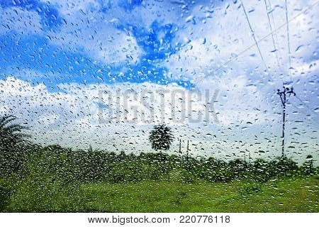 Natural water drop background.CAR Window glass with condensation of natural water drops .Abstract photo.Travelling and suddenly Rain breaks out giving me to capture this pictures. in the month of August.