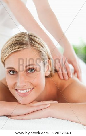 Close Up Of A Smiling Woman Relaxing On A Lounger During A Massage