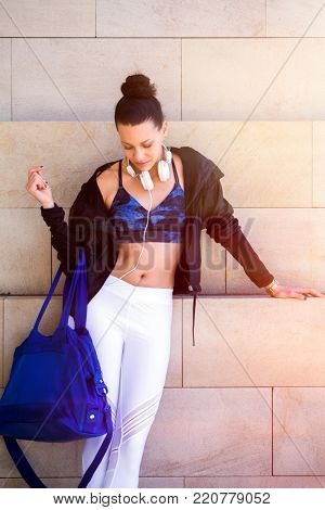 Personal trainer on the way to the gym. Street style sports wear.