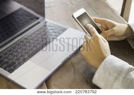 Online shopping with laptop and smart phone, stock photo
