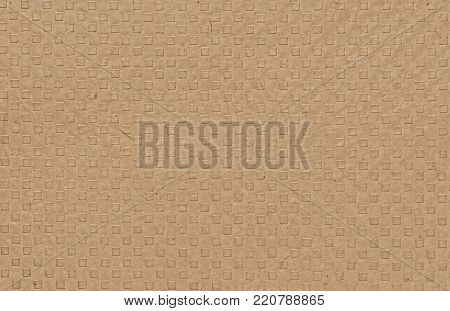 A sheet of brown paper with embossed squares