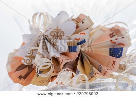 Two fifty euro bills folded in circular shape as a gift