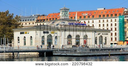 Geneva, Switzerland - 24 September, 2016: La Cite du Temps building, view from Pont des Bergues bridge. La Cite du Temps is a public exhibition center focusing on the world of time, hosting a wide variety of different exhibitions and activities.