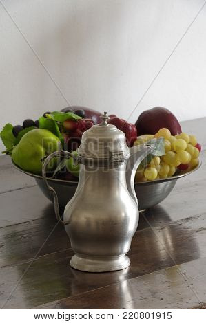 tin pitcher and a fruit bowl antique still life