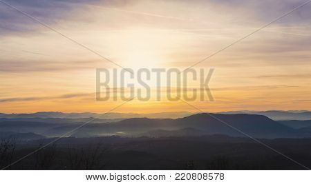 Sunset at the beginning of winter in Serbia. Central Serbia with its meadows, hills and forests.
