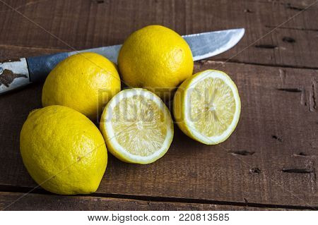 lemon paintings, lemons in different shapes, cut into two pieces of lemon with a knife, half lemons,