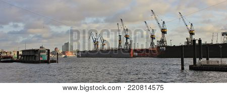 Dock and harbour cranes at the Elbe.