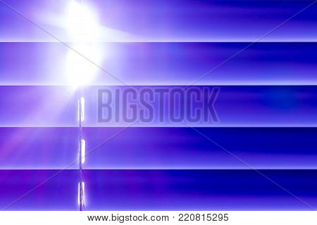 blue horizontal blinds on the window create a rhythm, through the intervals the light passes through