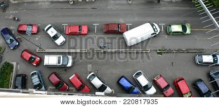 Aerial view of lot of cars parked on the busy street