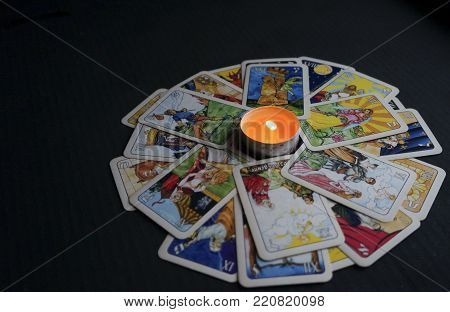 Yoshkar-ola, Russia - November 13, 2017: Fortune Telling On Tarot Cards On A Black Background With A
