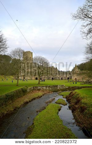 Fountains Abbey, Ripon, North Yorkshire, England, UK - December 27, 2016 : The historical 13th century Fountains Abby a UNESCO World Heritage Site