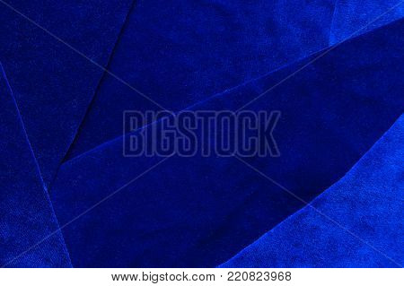 Beautiful luxury dark blue patchwork velvet texture background cloth. flaps of velvet fabric with a reflection