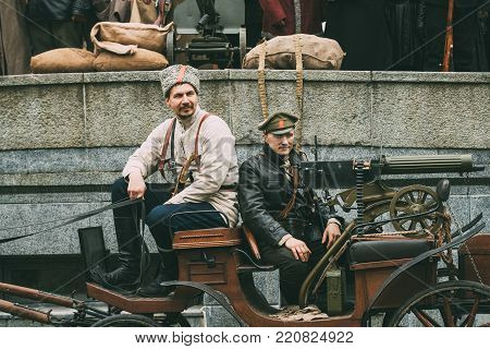 Gomel, Belarus - November 7, 2017: Celebration For The Century Of October Revolution. Reenactors In The Form Of Bolsheviks Soldiers Sitting In Tachanka With Maxim Gun