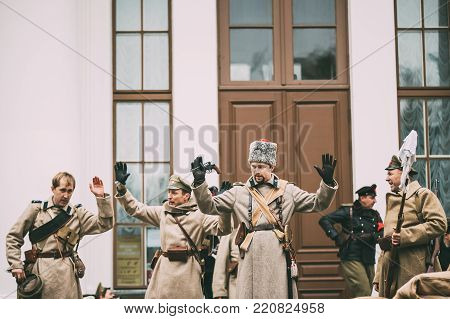 Gomel, Belarus - November 7, 2017: Celebration For The Century Of October Revolution. Reenactors In The Form Of White Guard Soldiers Of Imperial Russian Army Surrender To Captivity To Bolsheviks