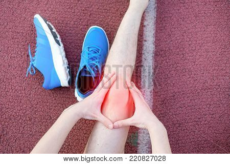 Ankle Injury And Man Runner Exercising With Leg Pain