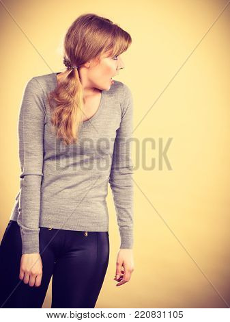 Argument disagreement and stress concept. Young blonde stressed angry woman portrait.