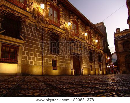 Town old quarter stone architecture night streetlights lights pavement facade soil texture