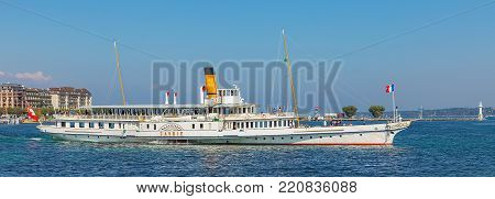 Geneva, Switzerland - 24 September, 2016: Lake Geneva as seen from the city of Geneva, MS Savoie passing with people on board. Lake Geneva is a lake on the north side of the Alps, shared between Switzerland and France.